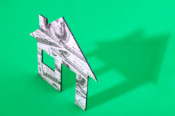 One hundred dollar bill house model for escrow account