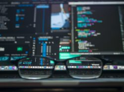Glasses in front of screens displaying home mortgage scams